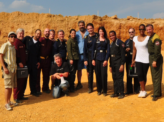 The cast and some of the crew of Polaris (standing, from left to right): Romel Punsal, Frank Hernandez, Carl Leonard, Maurice Molyneaux, Rick Pike, Eric Ebersole, Gina Hernandez, Barry Dunaway, Paul R. Sieber, Susan Cirrincione, Dean Roges, Doug Caprette, Tonya Broughton, John Broughton. (Kneeling): Dennis Bailey